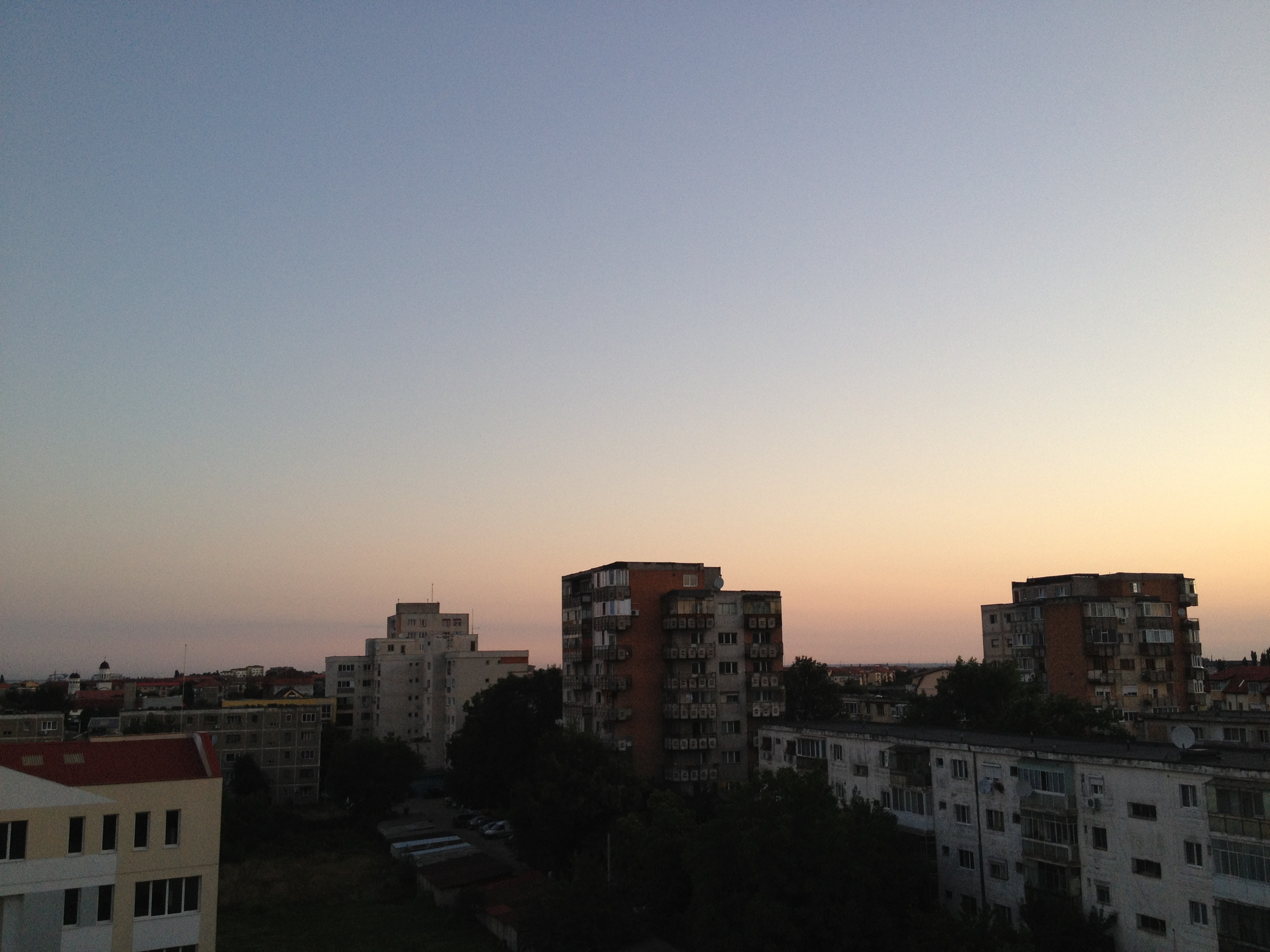 Dawn from my room in Timisoara, Romania. The view includes communist-era apartment buildings.
